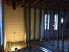 Framing men's restroom facing east wall