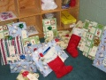 Gifts wrapped and ready to give to two Agape children