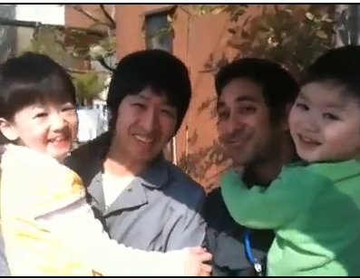 Two workers and two neighborhood children