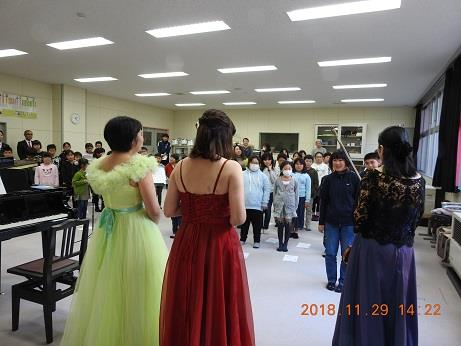 Performers greeting the students of the Natori Elementary School