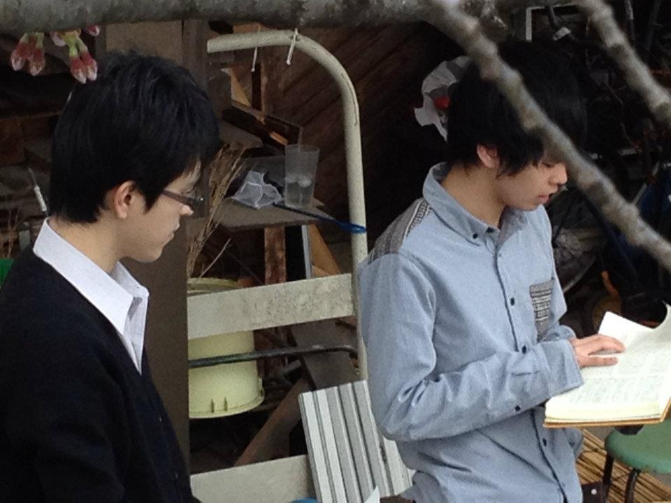 Toru reading Scripture before his dad\'s baptism