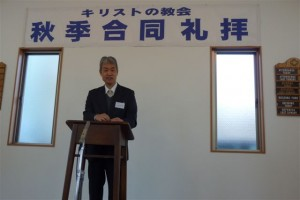 Ataka-san, minister for the Omika church in Ibaraki Prefecture, greets the assembly.