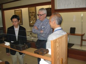 Brother Aikawa and I listen to the museum curator explain one of the exhibits.